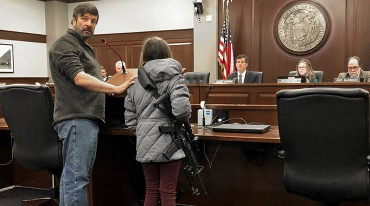 Girl carrying AR-15 assault rifle in Idaho legislative hearing