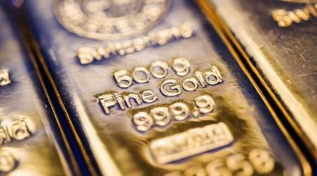 global gold price tuesday, PRECIOUS - Gold eases as equities rally, Hong Kong woes limit losses, European shares near 11-week high, US stock futures clear 3,000 level, US consumer confidence data due at 1400 GMT, precious metals news, commodity market news, business news india, indian express business news, indian express market news
