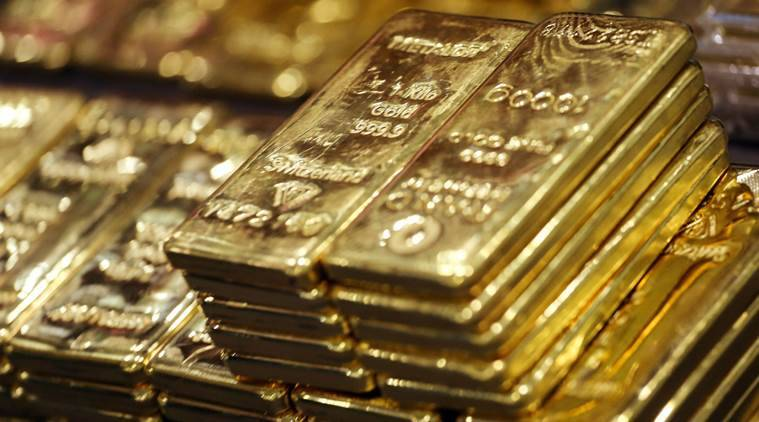 Gold firms on safe-haven demand, but stronger dollar caps gains
