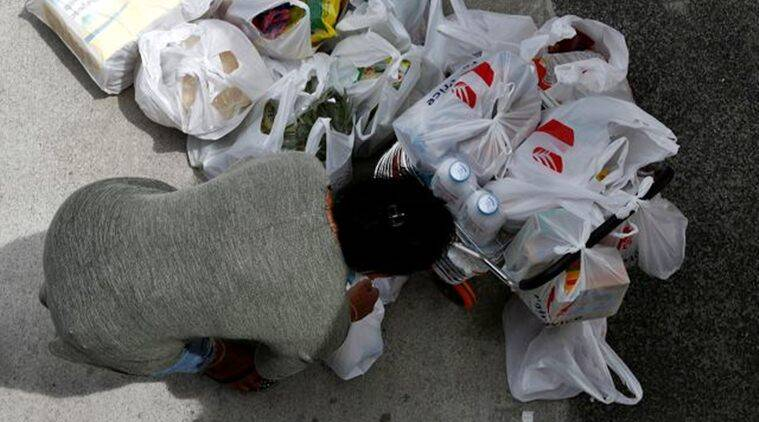 In China's locked-down coronavirus city, grocery delivery is a lifeline