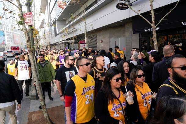 Fans wait in line before the public memorial for NBA great Kobe Bryant, his daughter and seven others killed in a helicopter crash, at the Staples Center in Los Angeles