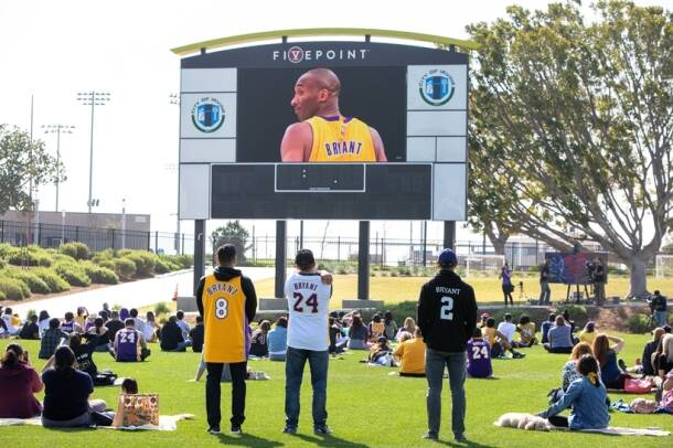 Fans gather at a public memorial viewing for NBA great Kobe Bryant, his daughter, and seven others killed in a helicopter crash, at the Orange County Great Park soccer stadium in Irvine, California