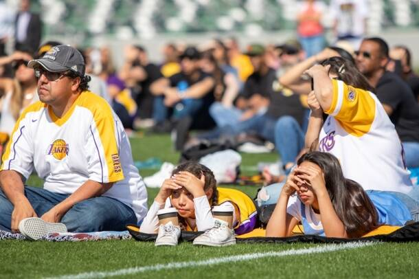 Fans gather at a public memorial viewing for NBA great Kobe Bryant, his daughter, and seven others killed in a helicopter crash, at the Orange County Great Park soccer stadium in Irvine, California.