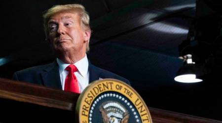 Donald Trump faces credibility test as he plays down virus threat