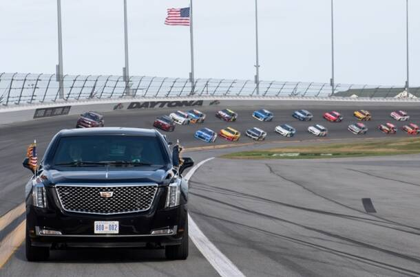 US President Donald Trump and First Lady Melania Trump ride in the Presidential limousine as they take a pace lap ahead of the start of the Daytona 500 Nascar race at Daytona International Speedway in Daytona Beach, Florida