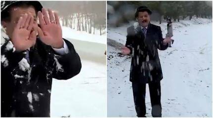 Video of TV weatherman braving snow attack by locals goes viral