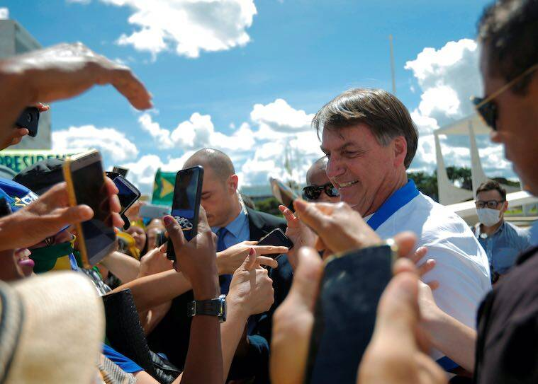 Brazil's President Bolsonaro meets supporters during a protest against Brazil's Congress and Brazilian Supreme Court, in front of the Planalto Palace in Brasilia