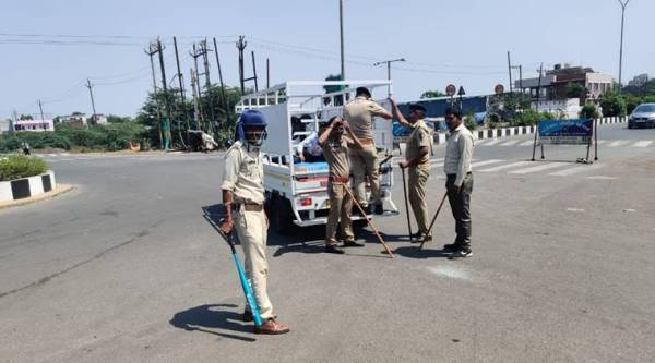 Migrant workers stopped in Surat; police use teargas after stone-pelting, detain 96