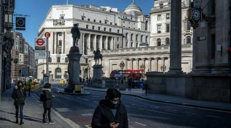 Pedestrians are scarce in the City of London, the financial district, during what is normally the morning rush hour on Monday, March 23, 2020.