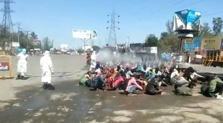 Bareilly: Migrant workers bathed in the open with sanitiser before entering district