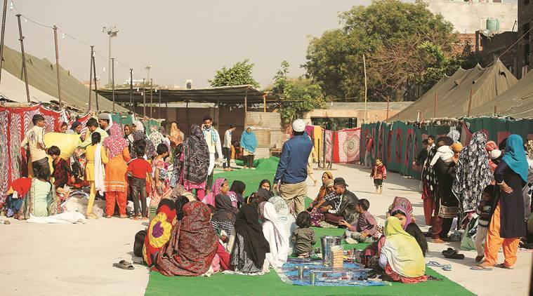 Delhi: Riot-hit families line up outside Eidgah in Mustafabad, now a relief centre