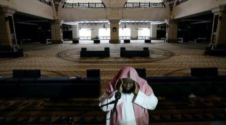A cleric calls for the prayer at an empty Al-Rajhi Mosque, as Friday prayers were suspended following the spread of the coronavirus disease (COVID-19), in Riyadh