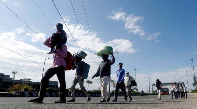 No work and food, migrants take long walk back home