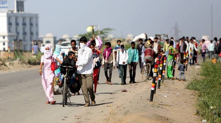 Coronavirus: Anger as migrant sprayed with disinfectant in India