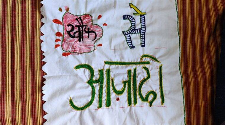 Women protesters make 'Azaadi Quilt' with slogans and motifs embroidered on scrap cloth