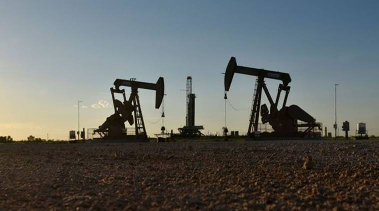 Oil jumps 8% on stimulus hopes, spending cuts by US producers