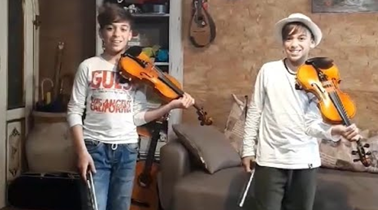 Twins play cold play song on violin, Italian twins play Coldplay song on violin, Coldplay Viva la Vida, Coldplay Viva la Vida violin version, Viva la Vida violin version, Italy, Trending news, Indian Express news