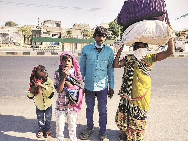 Walking home, migrant workers, india lockdown, coronavirus, ahmedabad news, indian express news