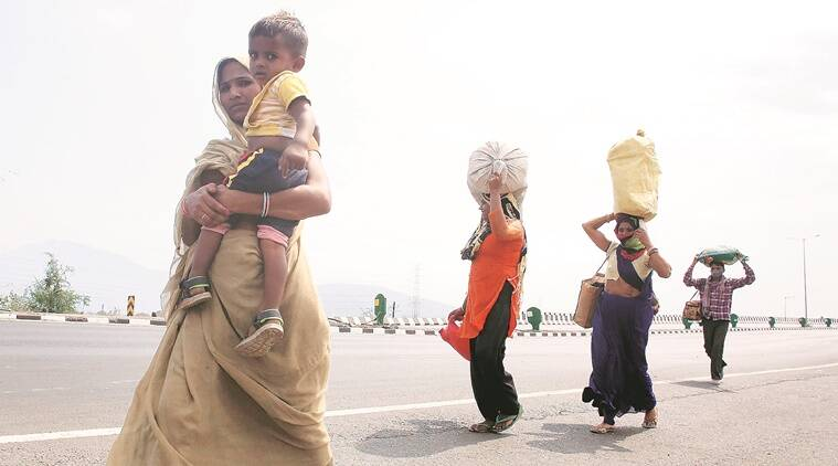 ahmedabad migrants, migrants from mp, migrant crisis, migrant labour, india lockdown, ahmedabad news, indian express