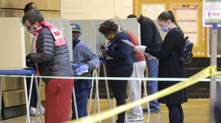 Long lines and frustration as Wisconsinites vote during coronavirus pandemic