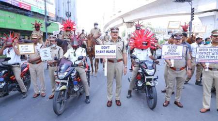 Covid-19 helmet, dance, aartis: Cops show their quirky side to spread awareness on coronavirus