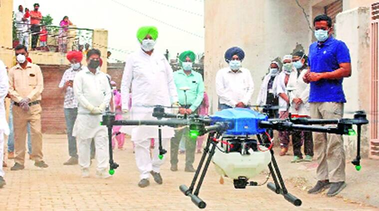 coronavirus, coronavirus in punjab, punjab health minister, balbir sing sidhu, balbir singh sidhu sanitation drive in punjab, sanitation drive in punjab, sanitation drive through drones in punjab, drones, drone use, indian express news