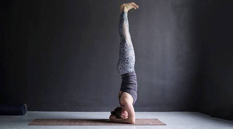 Want to try sirsasana? Here's a guide for beginners