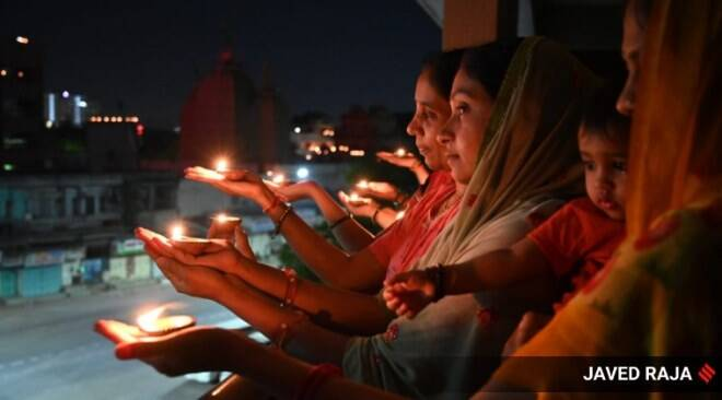 India responds to PM Modi's appeal; lights candles, diyas, mobile phone torches