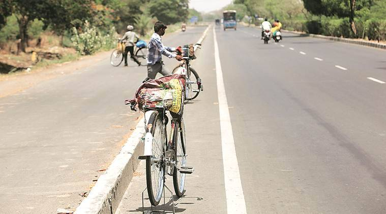 coronavirus, coronavirus news, covid 19 tracker, covid 19 india tracker, UP migrants in Surat, Surat migrants on cycle, migrant exodus, Indian express