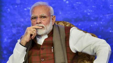 pm modi, narendra modi, COVID-19, coronavirus, narendra modi guardian in chief, indian express