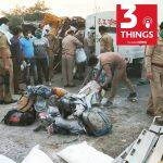 Police officials inspect the spot where atleast 26 people were killed and 36 injured two trucks carrying workers collided at Mihauli in Auraiya district