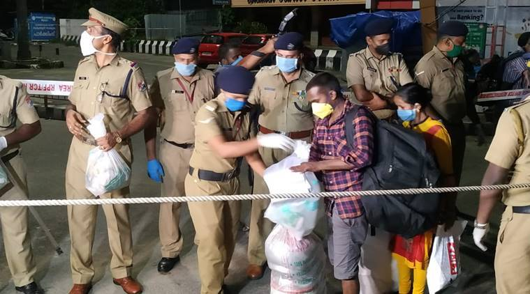 Police officers in Aluva provide water to passengers. (Express photo)