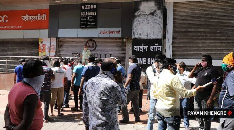 Queue in front of closed alcohol store in Pune