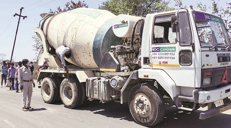 From belly of a concrete mixer, emerge 14 migrants headed from Maharashtra to UP