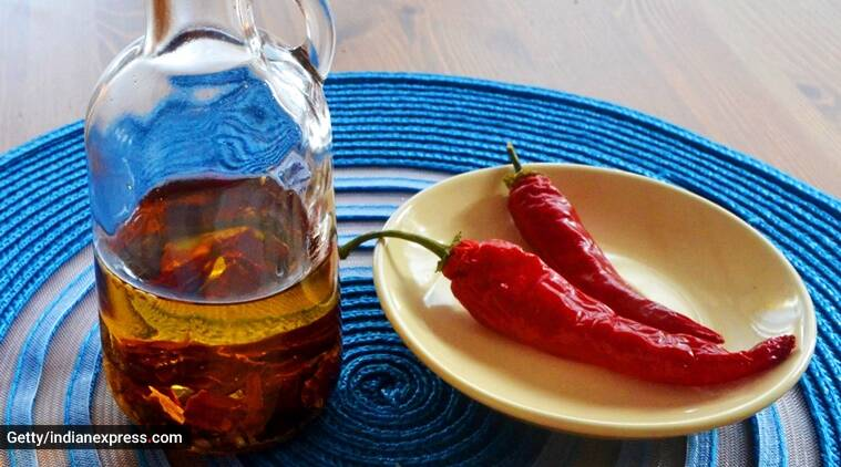 chilli oil, how to use chilli oil, how to make chilli oil, make chilli oil at home, make chilli oil DIY, make chilli oil easy recipe, indian express