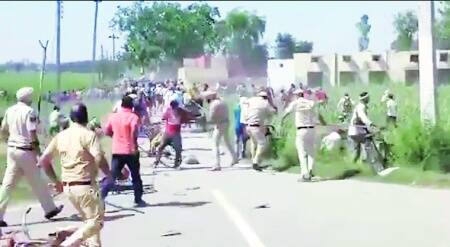 Haryana govt faces flak over video of police lathi-charging migrants