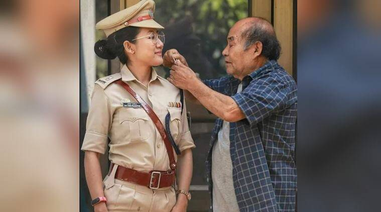 manipur police, manipur police female officer, dad checks daughter uniform, father checks star on daughter uniform, viral news, indian express,
