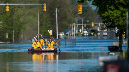 Michigan flood displaces thousands, threatens Superfund site