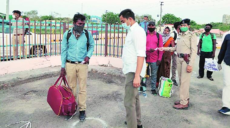 coronavirus, migrant workers, migrant workers in gujarat, migrant workers train tickets, gujarat police, indian express news