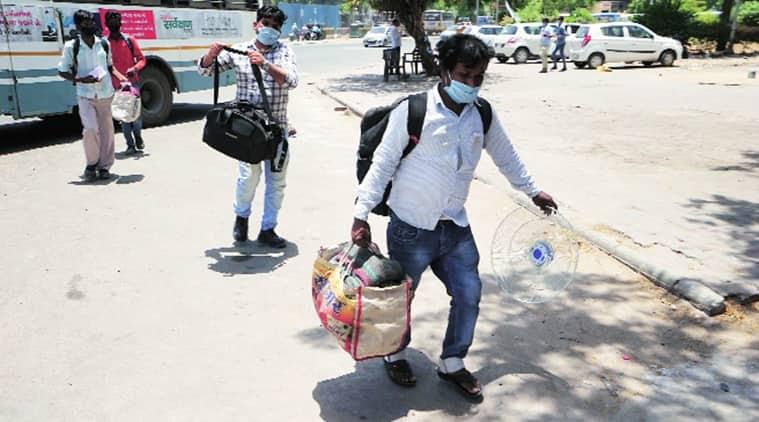 coronavirus, coromavirus in gujarat, covid 19 lockdown, migrant workers, migrant workers stuck, migrant workers in gujarat, migrant workers home, indian express news