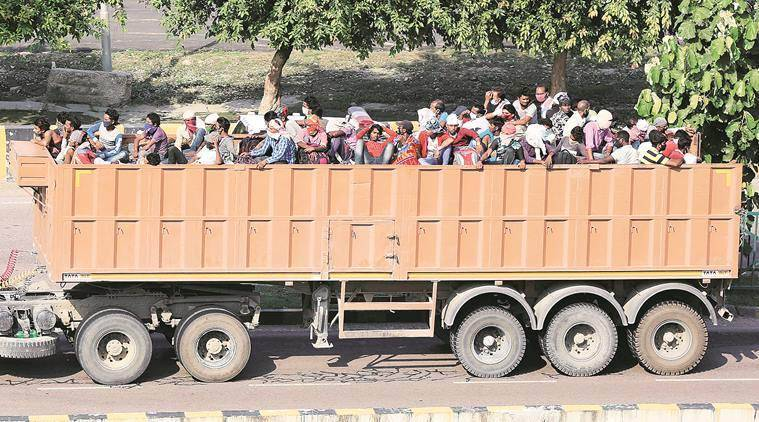 madhya pradesh migrant workers, UP migrant workers crossing madhya pradesh, migrant workers crisis, india lockdwon, migrant workers killed in accident, mp accident, indian express