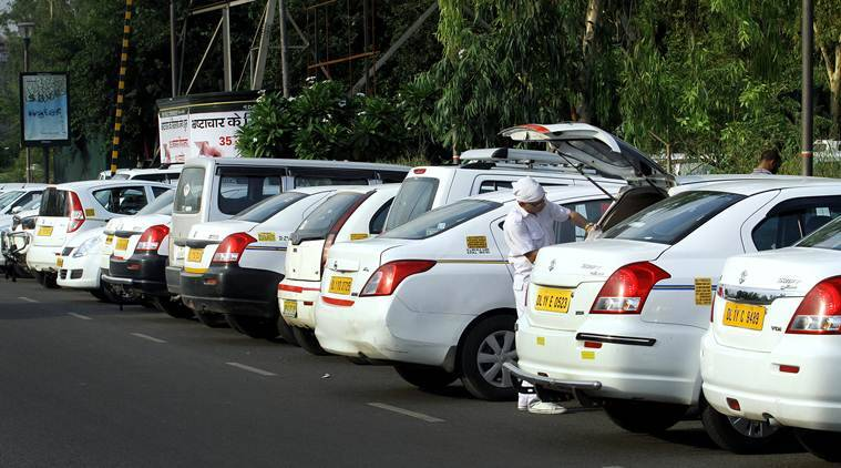Cabs of Uber and Ola drivers parked as they protesting outside the Delhi Secretariat after ban of Taxi services in New Delhi on June 4th 2015. Express photo by Ravi Kanojia.