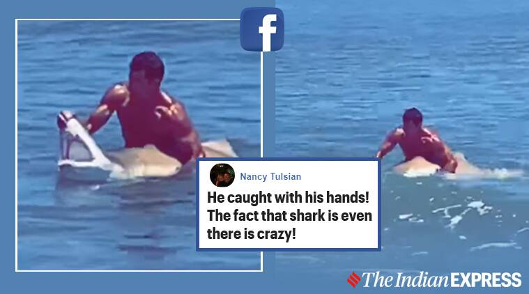 shark, shark US, man opens shark jaws, jaws, man holds shark jaw viral video