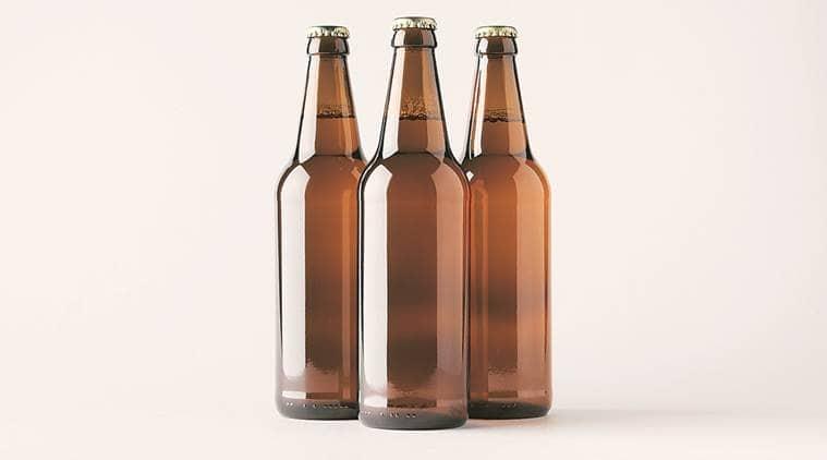 gujarat crime, indian made foreign liquor, imfl, imfl liquor siezed in gujarat, imfl liquor bottles seized from maruti car, indian express news