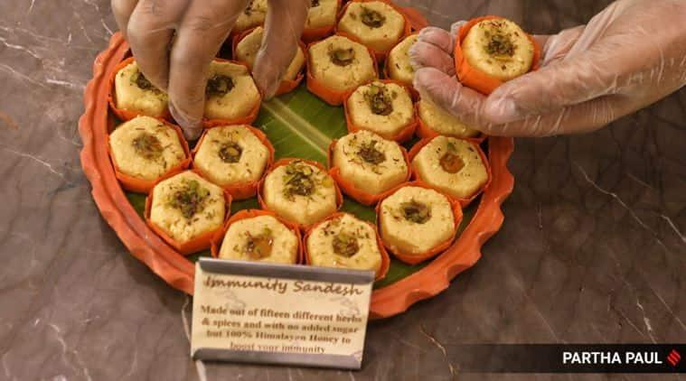immunity sandesh, kolkata immunity sandesh, Balaram Mullick and Radharaman Mullick, kolkata corona theme misti, kolkata sweets, viral news, bengal coronavirus updates, indian express