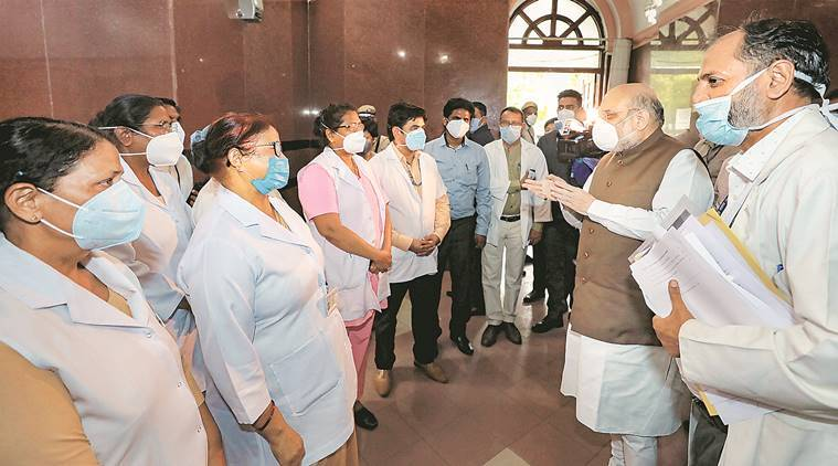 Amit Shah visits LNJP, says recovered should get good-health certificates