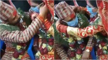 coronavirus, coronavirus wedding, lockdown marriage, quarantine wedding, nepali wedding, corona wedding ritual, mask exchange wedding ritual, viral videos, funny tiktok videos, indian express