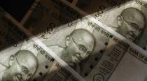 Rupee surges 14 paise to 75.28 against US dollar in early trade