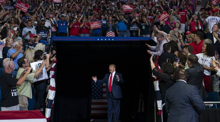 Trump comeback rally features empty seats, staff infections