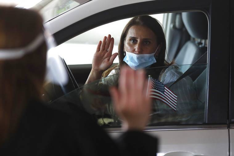 Drive-up US citizenship eases backlog, but new threat looms